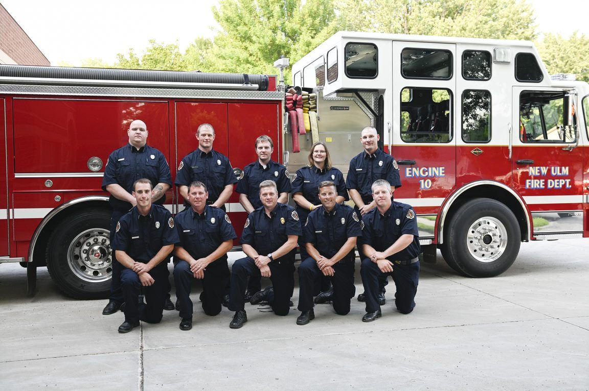 Engine Company Number 1 posed in front of a fire engine