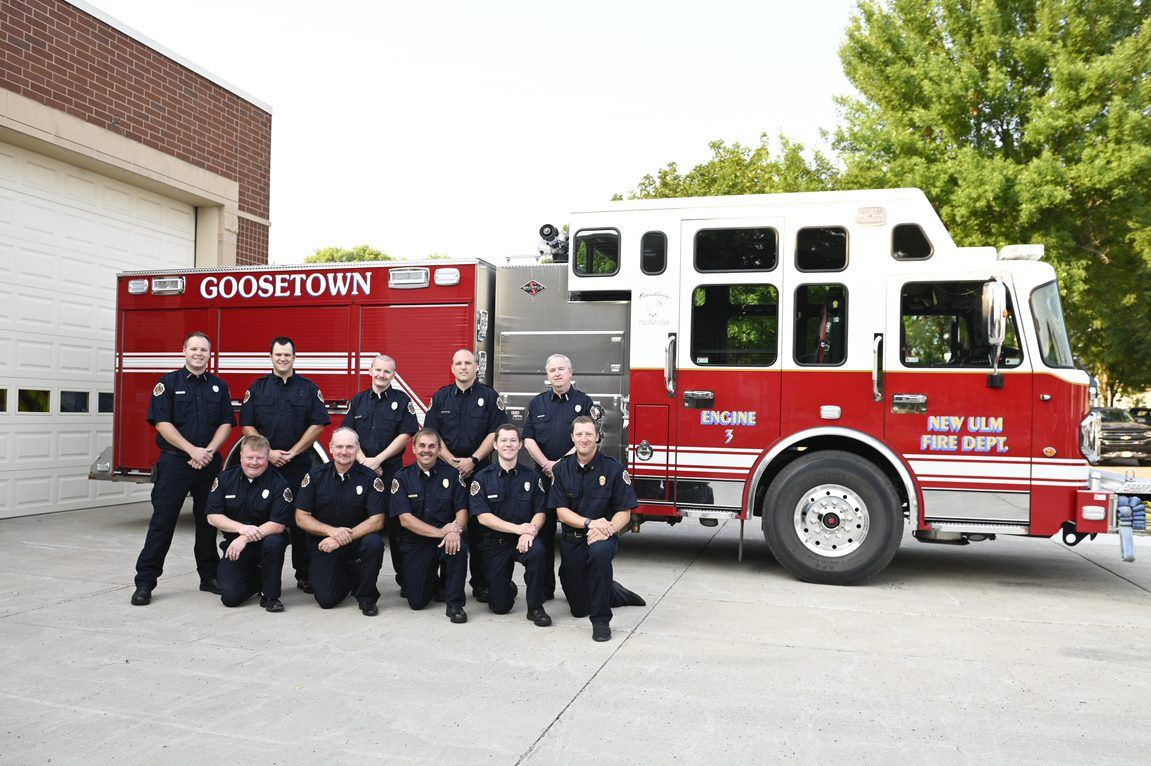 Engine Company Number 3 posed in front of a fire engine